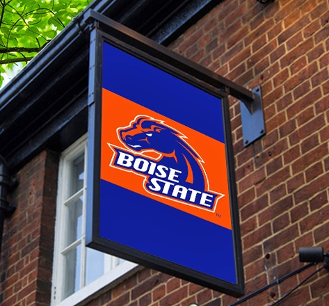 Digital sign with the Boise State logo on a red brick wall