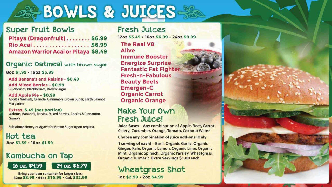 A bowls and juices menu board with smoothie and sandwich products with their prices