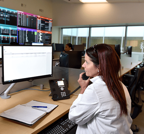 woman on a phone call in a computer/call center