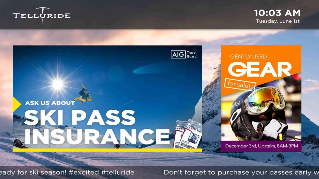 Advertising display with snowy mountain background and ski pass insurance advertisements