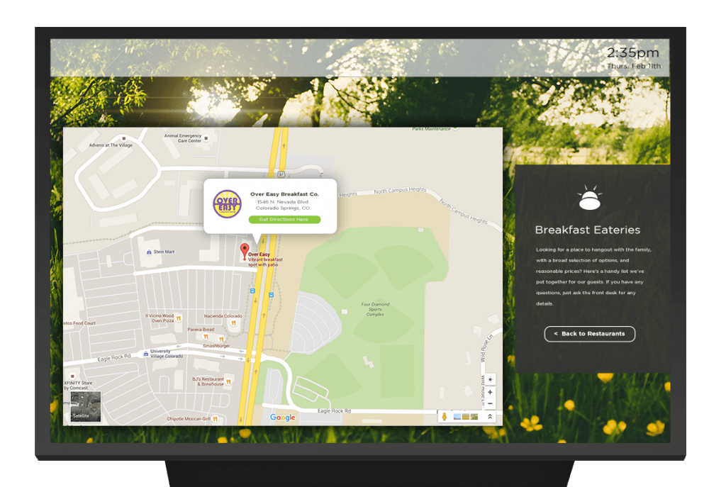 """a TV with a Google map widget and text box saying on """"Breakfast Eateries"""" on the right"""