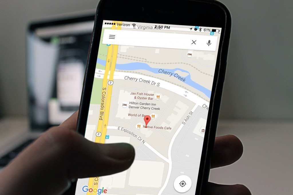 close-up image of someone holding a phone while using the google maps app