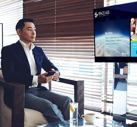 Image of a man watching financial video screen