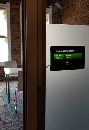 Image display tablet attach to wall of Meeting room