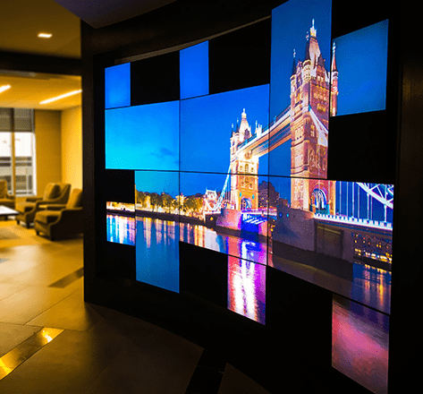 A mosaic video wall of the Tower Bridge in London, England in a professional business lobby